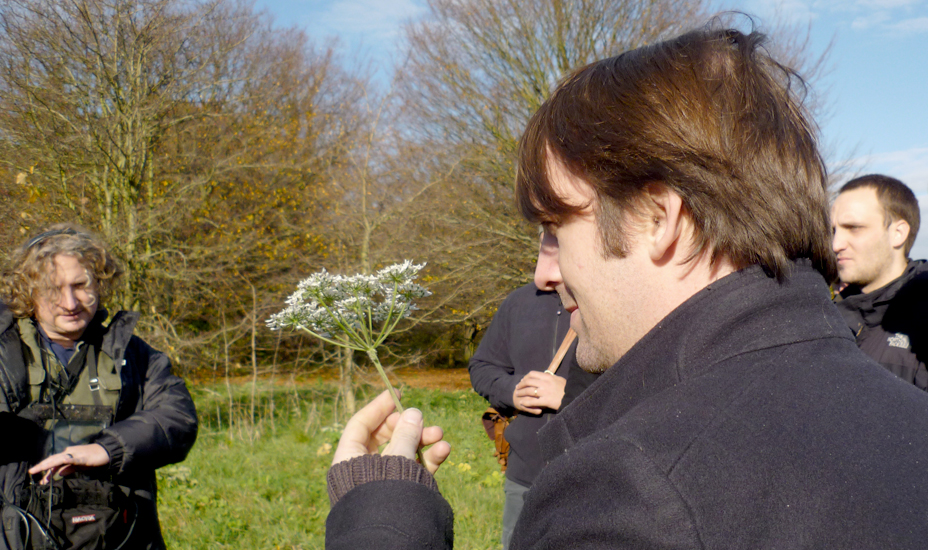 René Redzepi takes a close look at cow parsley on a Cook It Raw weekend while Where Chefs Eat author Joe Warwick (left) looks on