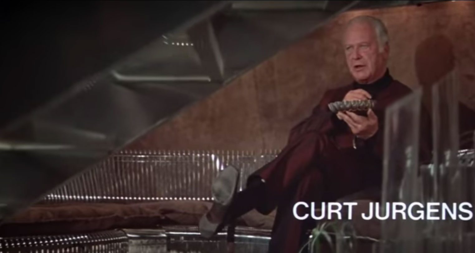 Bond villain Karl Stromberg (Curt Jurgens) reclines on a Pantonova sofa in the trailer for The Spy Who Loved Me