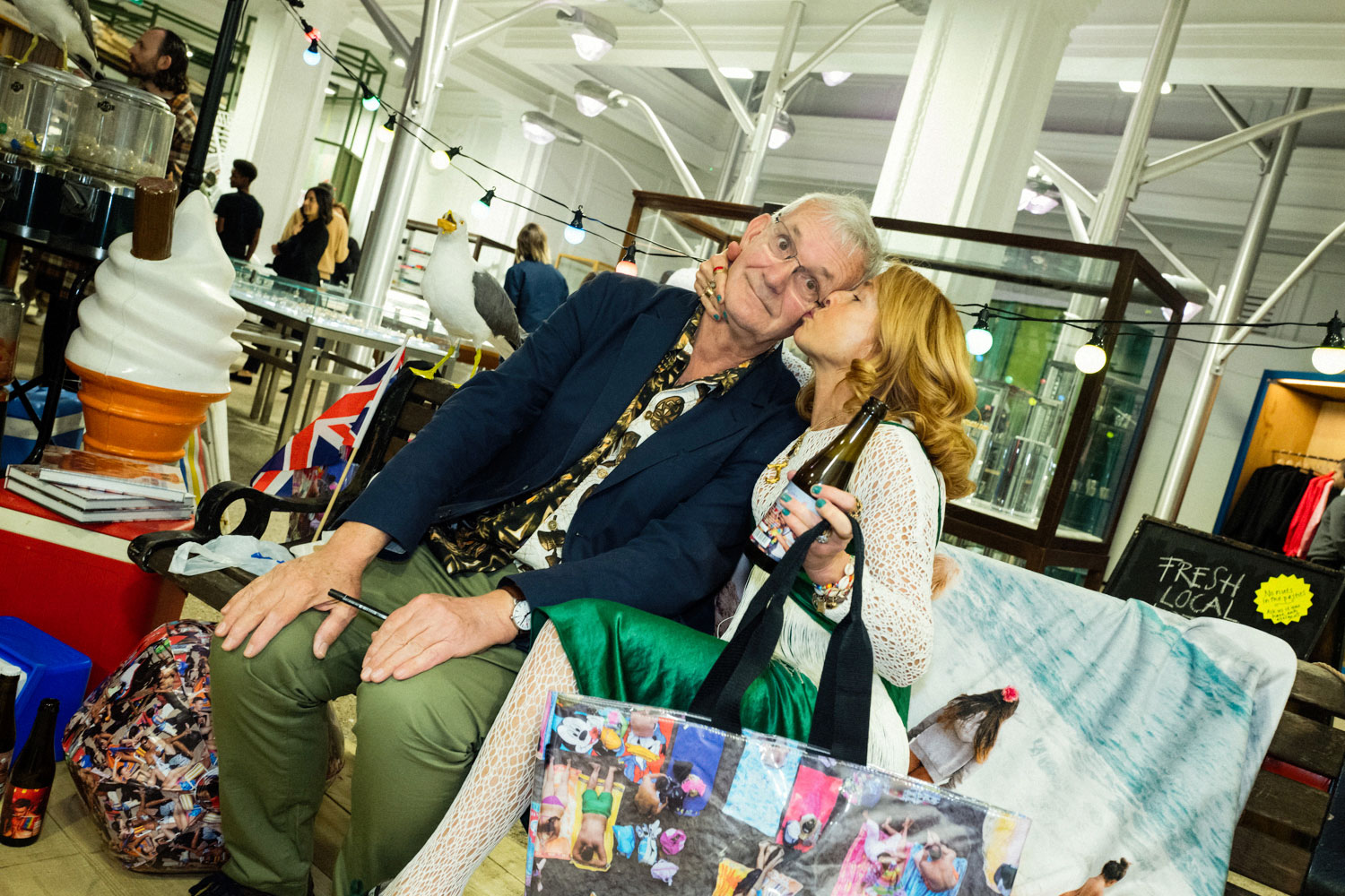 Martin Parr with a guest at Dover Street Market in London
