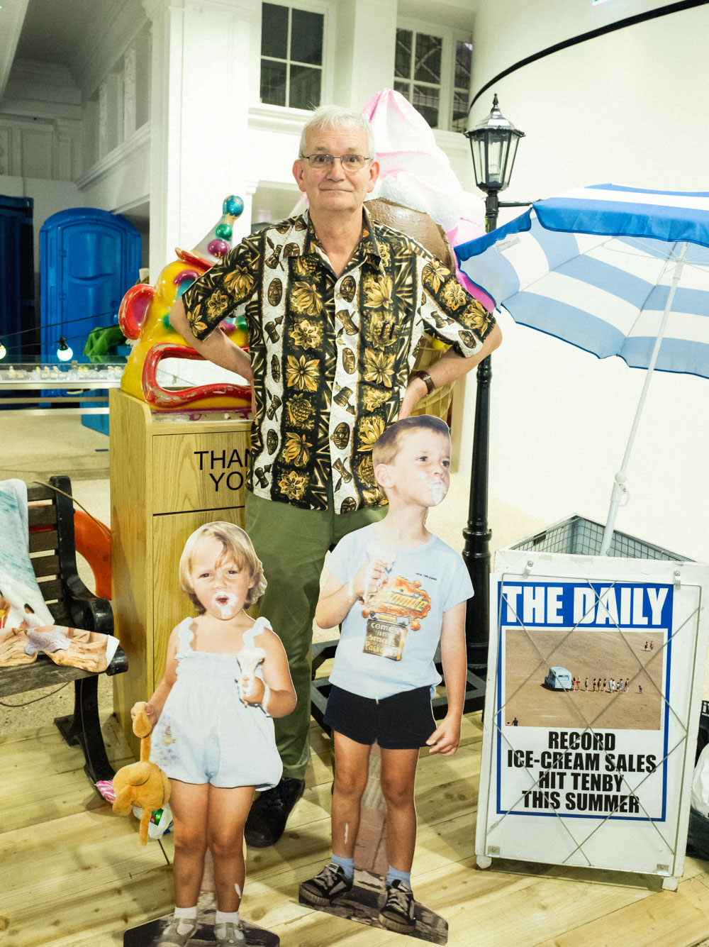 Martin Parr with cut-out figures from his 1985 photo story The Last Resort, at Dover Street Market in London