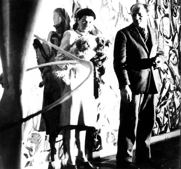 Peggy Guggenheim and Pollock in front of Mural, in the hallway of her town house, c.1944. From our Phaidon Focus book