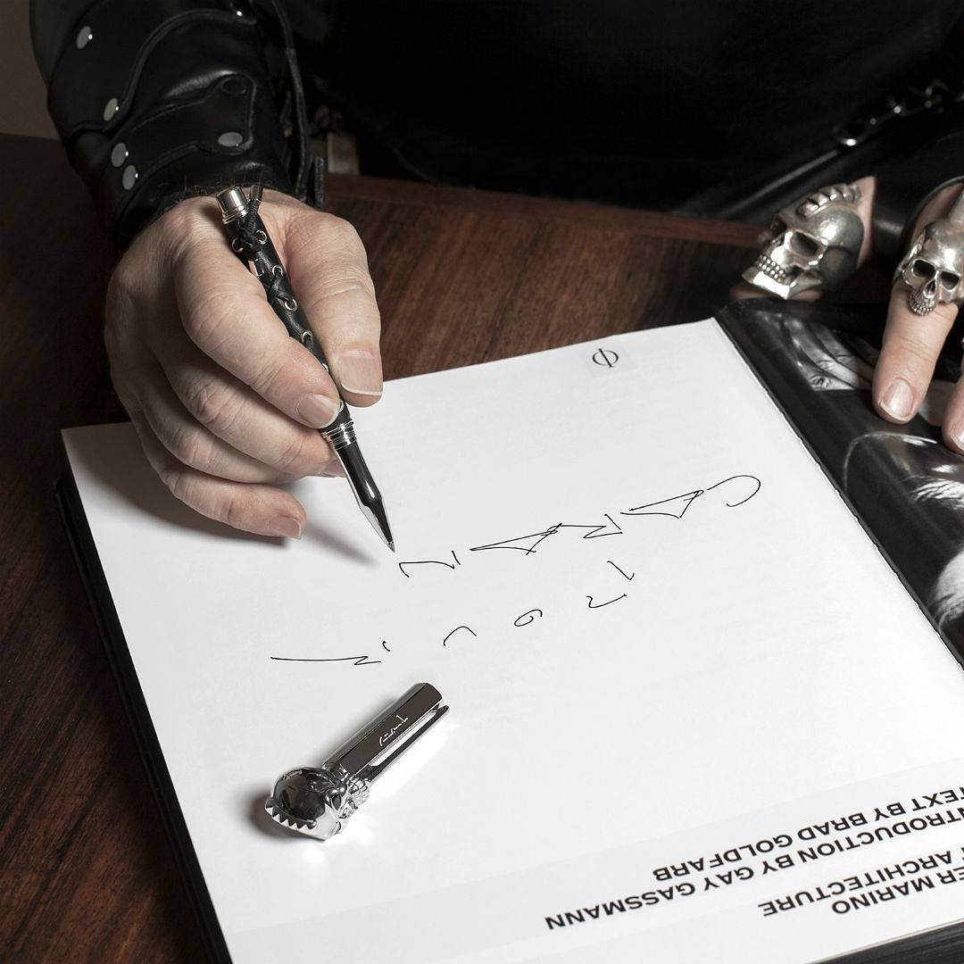 Peter Marino signing his Phaidon book with his Varius pen. All images courtesy of Caran d'Ache's instagram