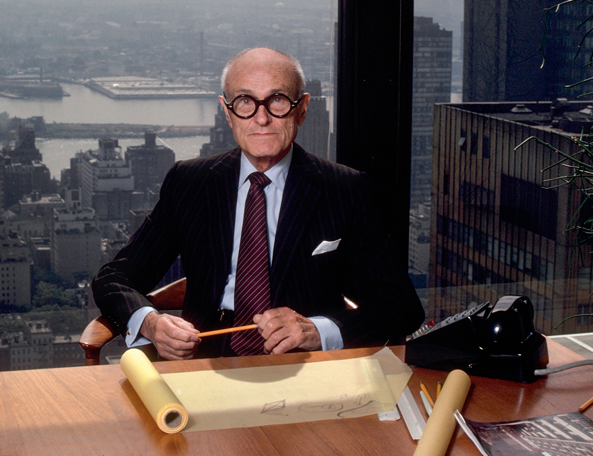Philip Johnson at his desk in his New York office in the Seagram Building, 1982