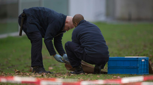 Police make a search of the museum grounds the day after the theft in October
