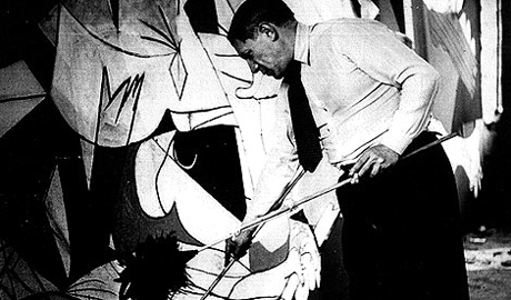 Picasso painting Guernica (1937)