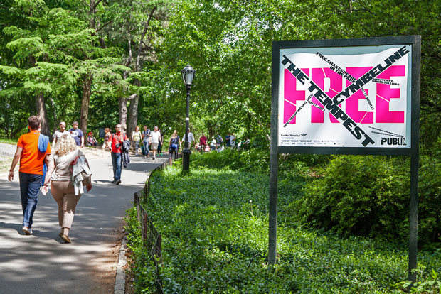 A poster from the new campaign on the path to the Delacorte Theater in Central Park. Photo by Claudia Mandlik. Courtesy of Pentagram