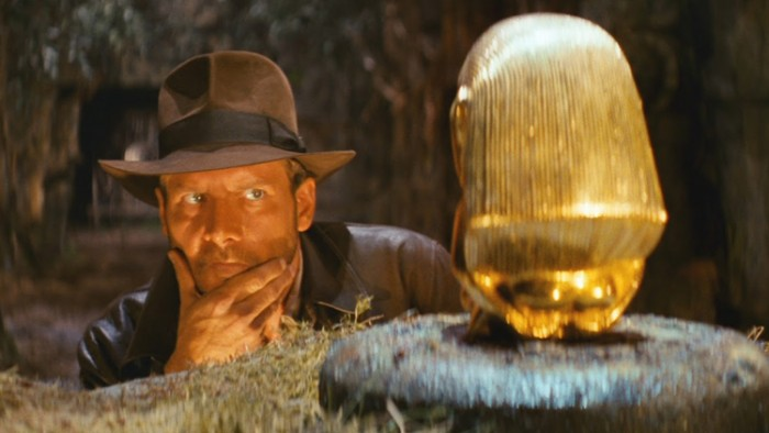Indiana Jones with the gold replica of the 'Aztec birthing figure' from Raiders of the Lost Ark (1981)