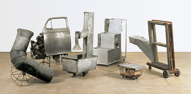 Oracle, 1962-65 - Five-part found metal assemblage with five concealed radios: ventilation duct; car door on typewriter table, with crushed metal; ventilation duct in washtub and water, with wire basket; constructed staircase control unit housing batteries and electronic component; and wooden window frame with ventilation duct