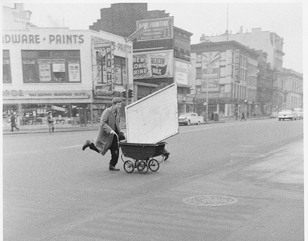 Red Grooms transporting an artwork to Reuben Gallery, New York, 1960 (detail) photo by John Cohen, . Gelatin silver print, 10 x 6 3/4 in. © John Cohen. Image courtesy of the Grey Art Gallery