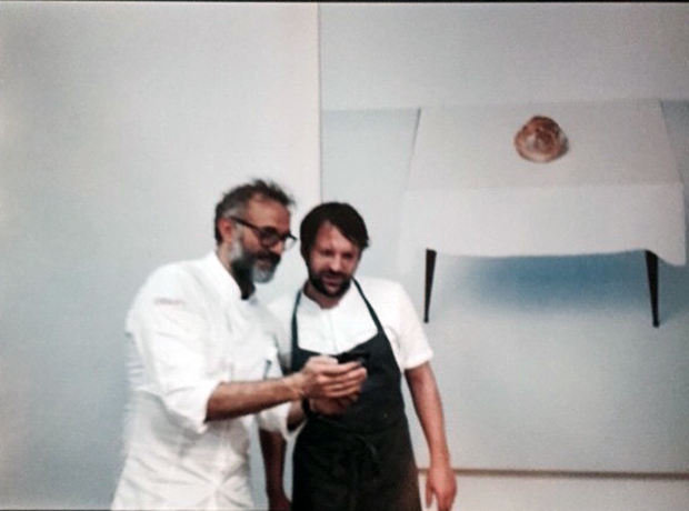 René Redzepi and Bottura with the staff at Refettorio Ambrosiano. Image courtesy of Bottura's Instagram
