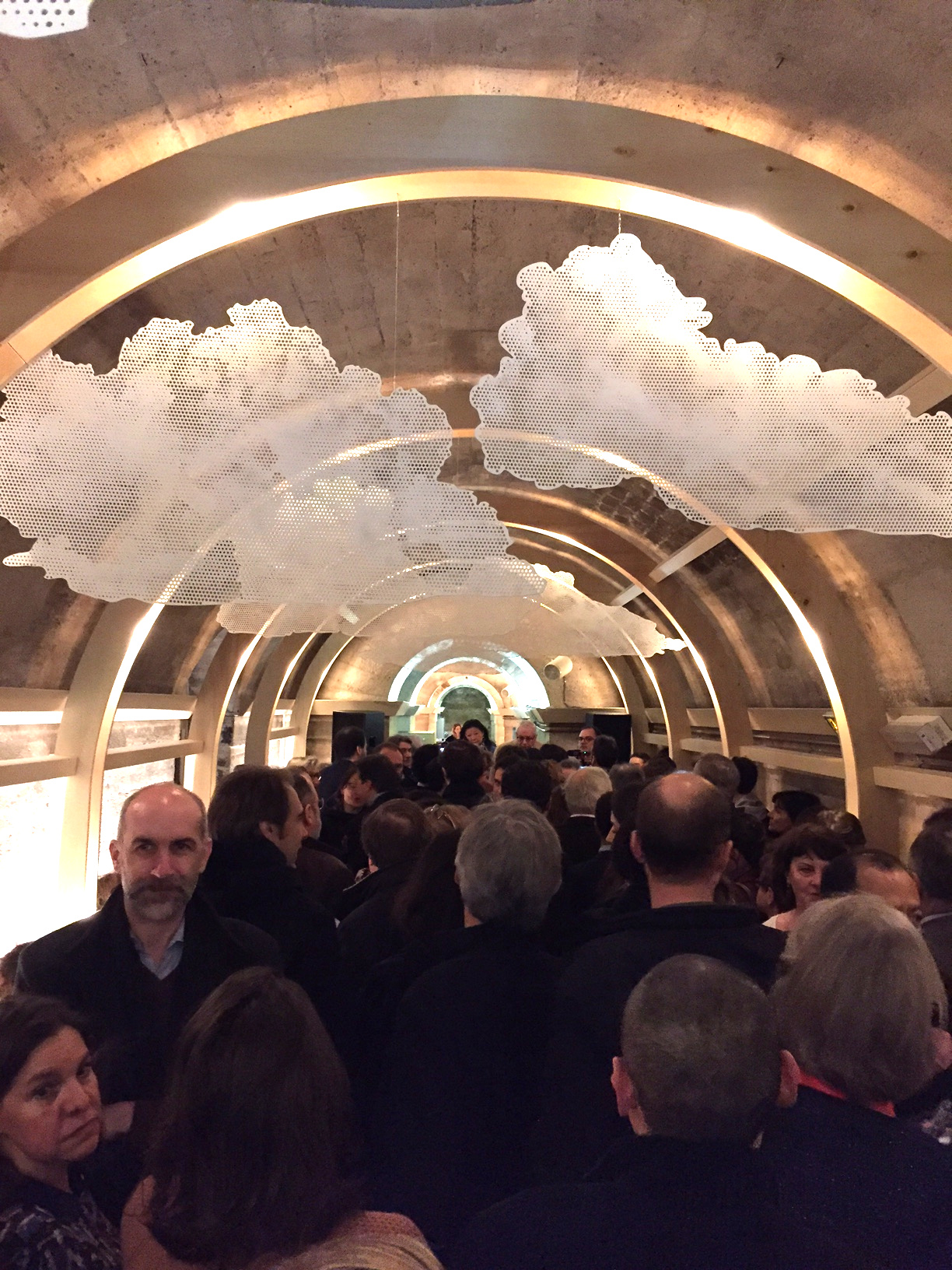 Guests gather at the new Refettorio Paris in the crypt of the L'église de la Madeleine