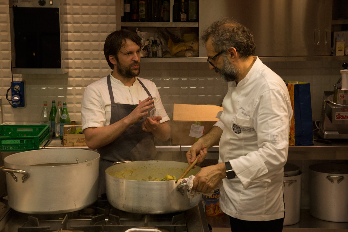 René Redzepi and Massimo Bottura at Refettorio Ambrosiano, as reproduced in Bread is Gold. Photo by Emanuele Colombo