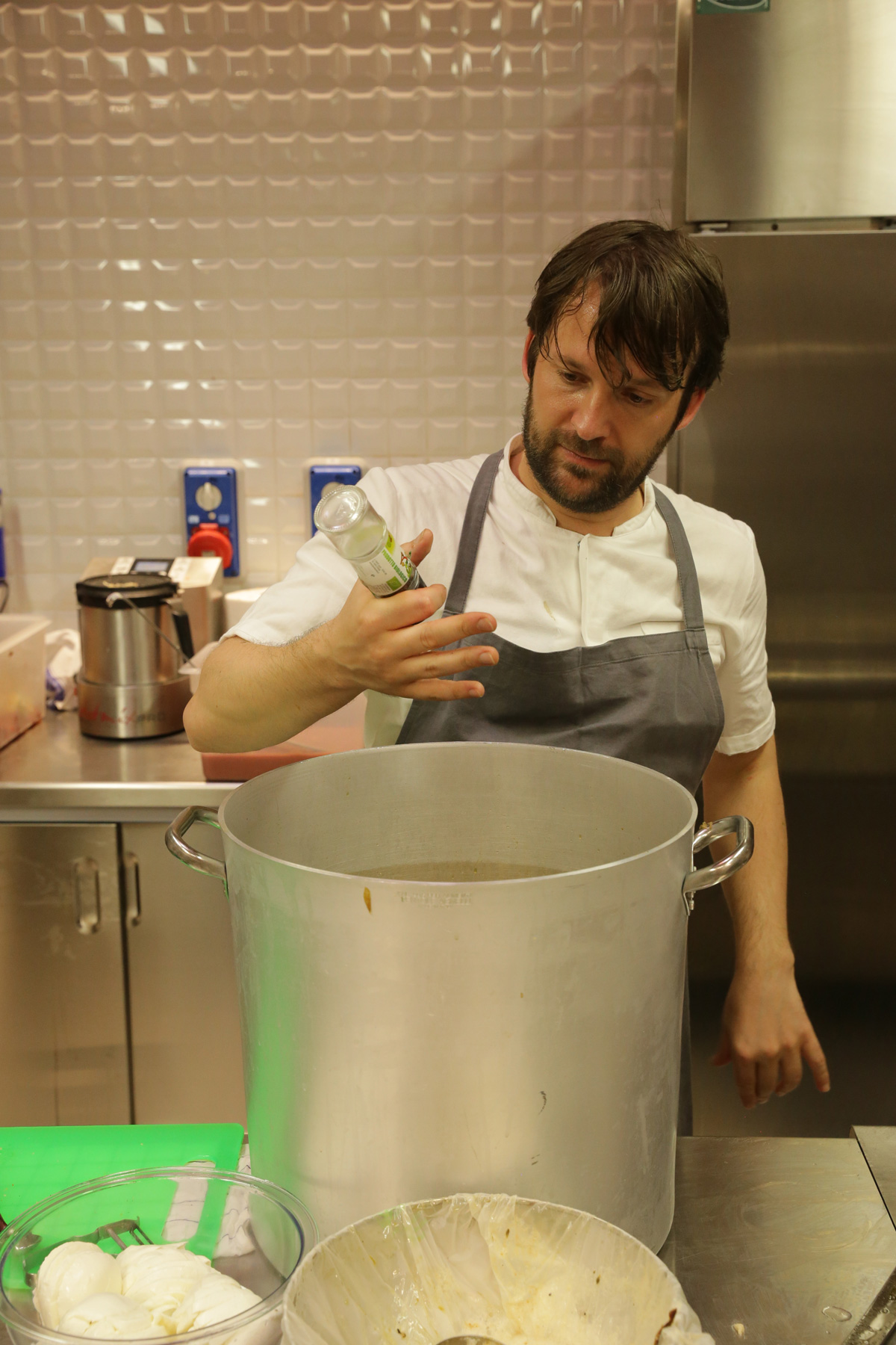 René Redzepi at Refettorio Ambrosiano, as reproduced in Bread is Gold.  Photo by Emanuele Colombo