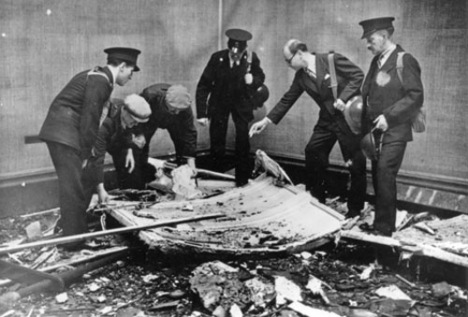 Tate Director John Rothenstein with Tate staff surveying the damage caused by a bomb which hit the Gallery on 16 September 1940. Image courtesy of The Tate