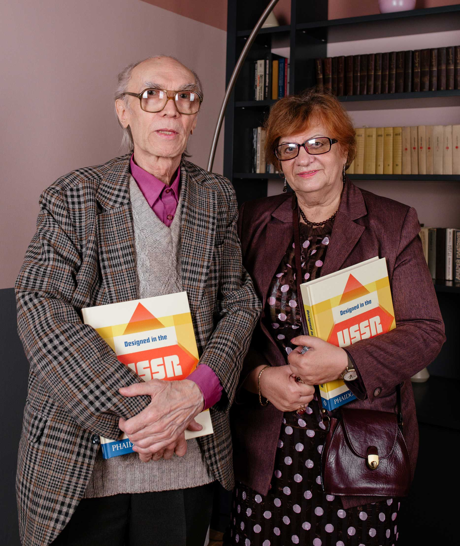 Two of the designers featured in Designed in the USSR: 1950-1989 holding a copy of the book photographed at the Tretiakov Gallery in Moscow last month Left: Alexander Grashin right unknown