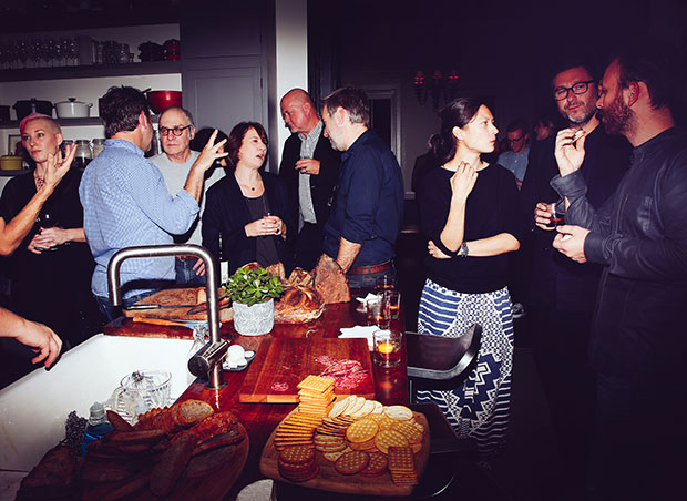 Guests enjoy aperitifs at Adam Sachs' Brooklyn house. Photograph by Michelle Heimerman
