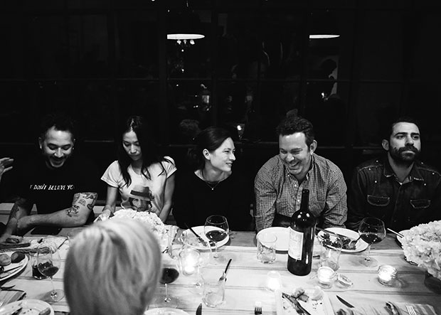 Guests enjoy Magnus's food at Adam Sachs' Brooklyn house. Photograph by Michelle Heimerman