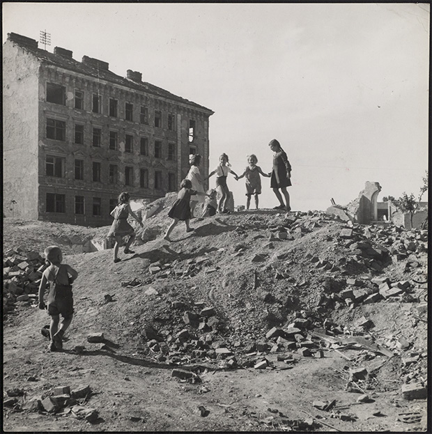 Children playing on a pile of rubble among the ruins, Vienna, Austria. From 'Children of Europe', 1948 © David Seymour/Magnum Photos