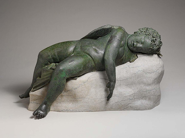 Statue of Eros Sleeping c. 3rd Century BC – early 1st Century AD, bronze, Metropolitan Museum of Art, New York. Michelangelo's marble Sleeping Eros sculpture, 1496, now lost, would have taken inspiration from this Hellenistic tradition