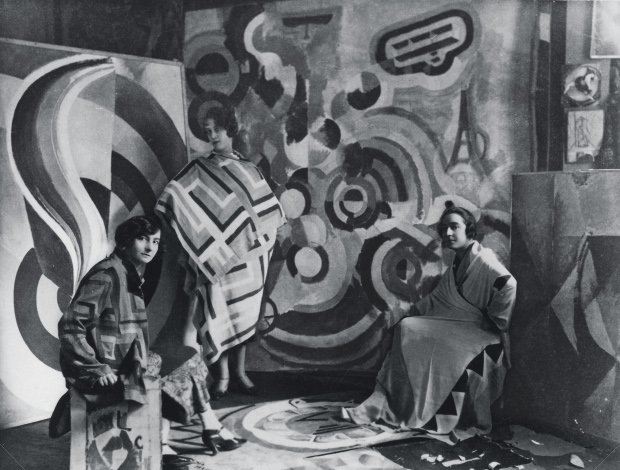 Sonia Delaunay (right) and two friends in Robert Delaunay's studio, rue des Grands-Augustins, Paris 1924. Image courtesy of Bibliothèque nationale de France, Paris