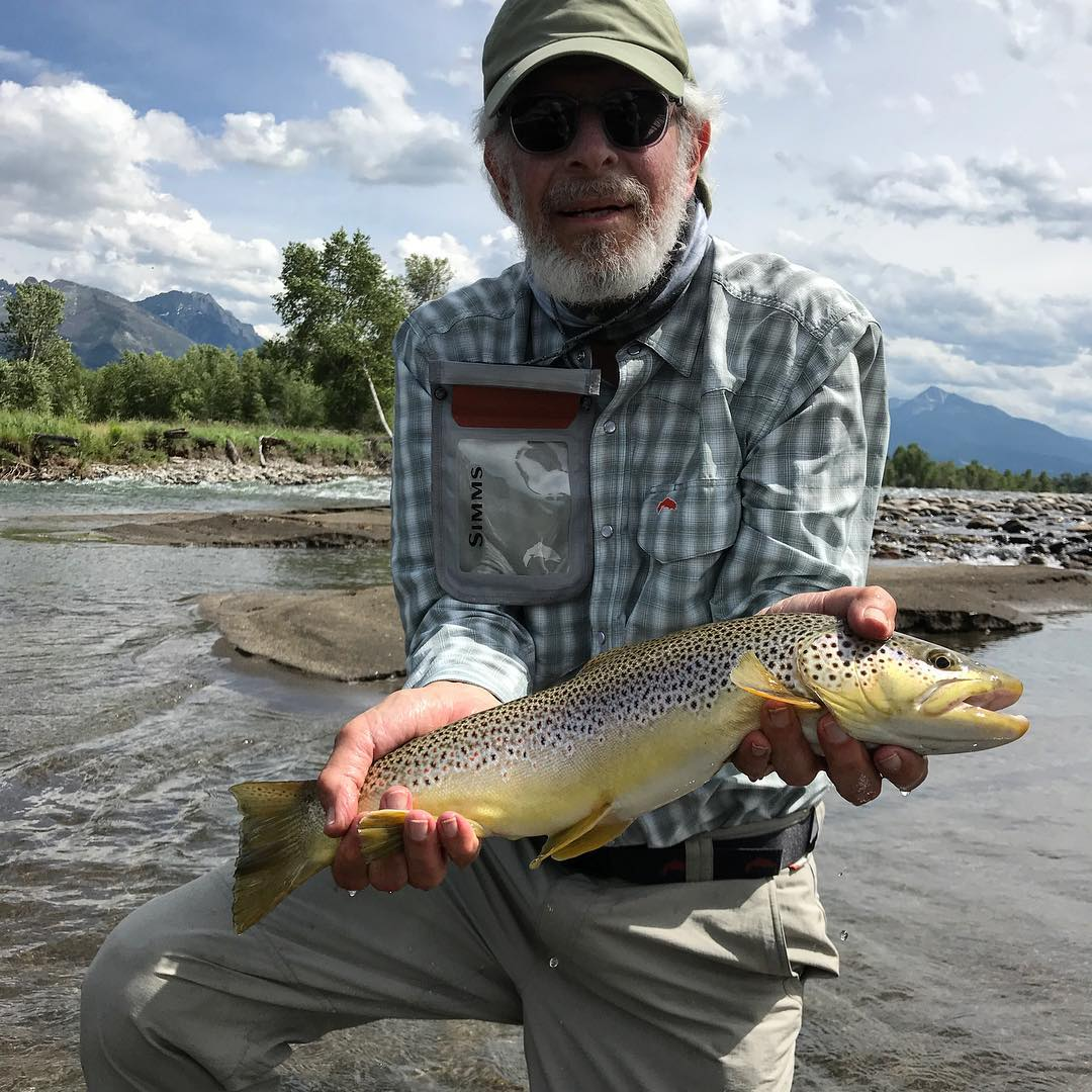 Stephen Shore with the trout he caught in the Yellowstone River. Image courtesy of Shore's Instagram
