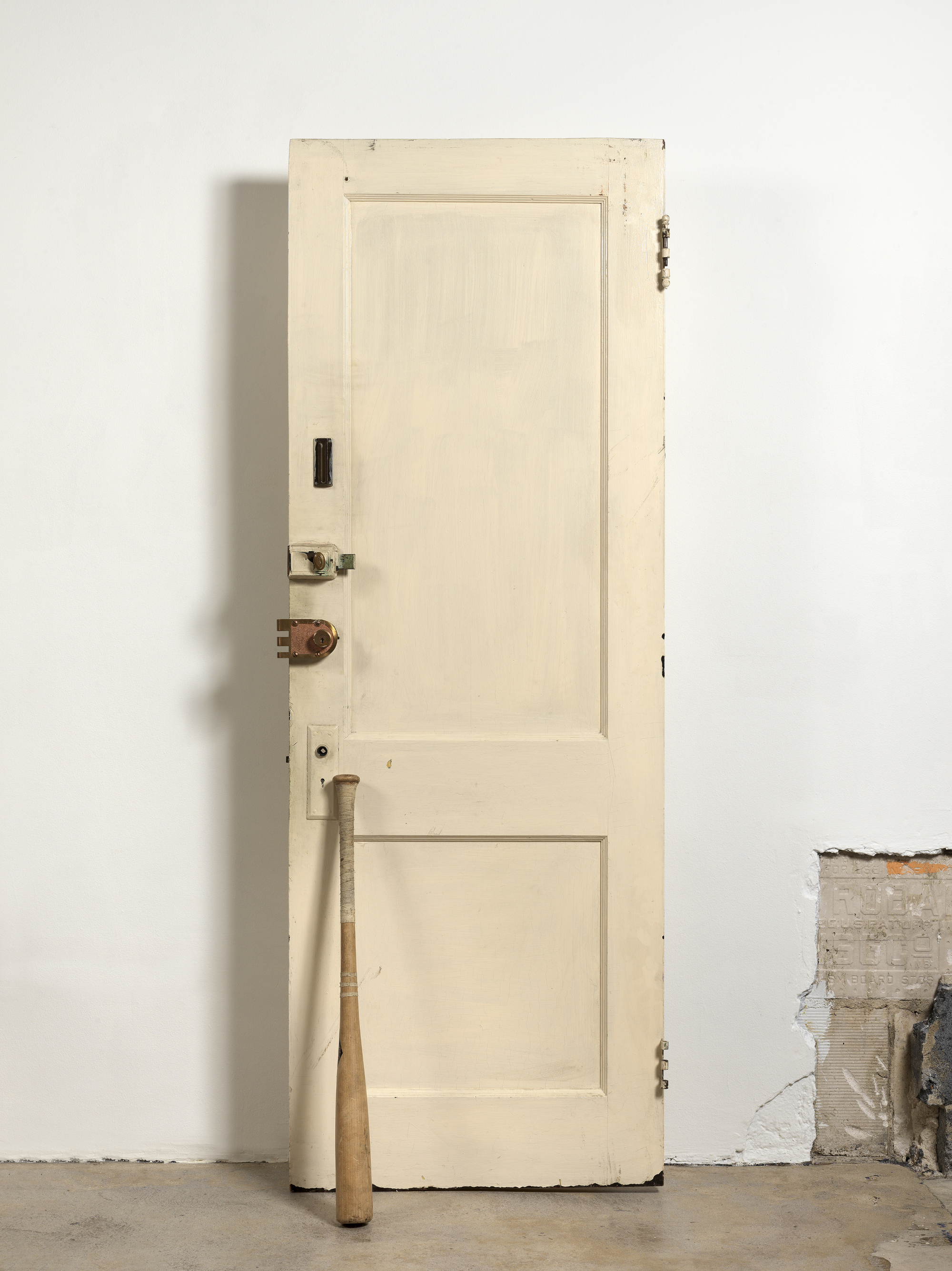 Diamond Stingily, Entryways, 2016. Door with locks, bat, 79 x 25 in (200.7 x 63.5 cm). Collection Dr. Gerardo Capo. Courtesy the artist and Queer Thoughts, New York.
