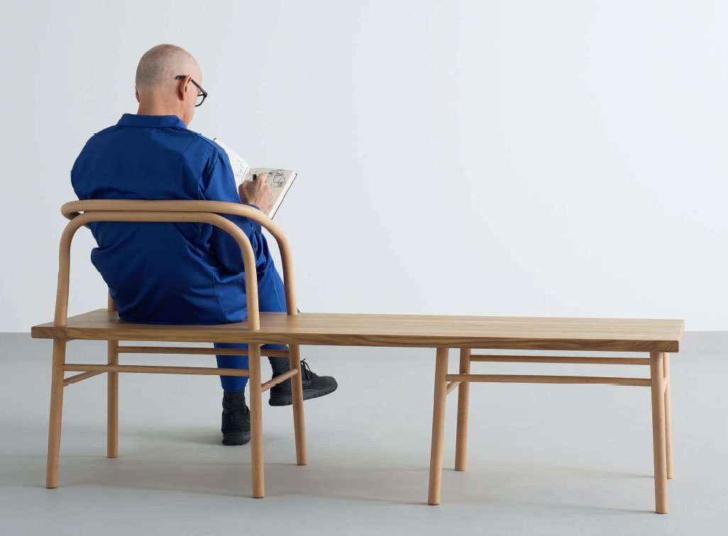 Fellow designer Durrell Bishop sitting on Industrial Facility's Table, Bench, Chair. As reproduced in our book, Industrial Facility