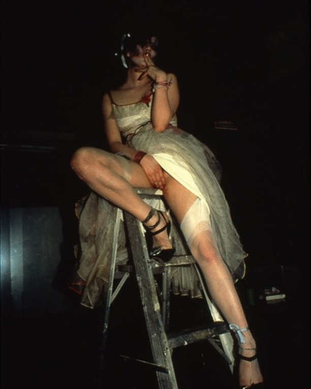 Trixie on the ladder NYC 1979 by Nan Goldin