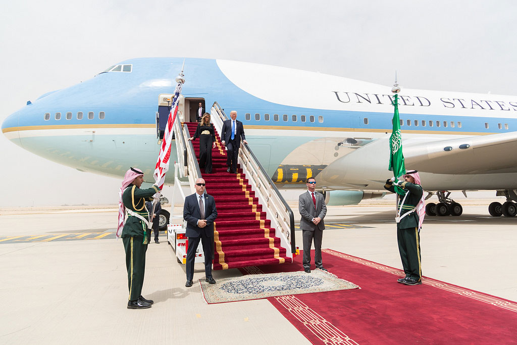 President Donald Trump and First Lady Melania Trump walk down red-carpeted stairs, Saturday, May 20, 2017, on their arrival at King Khalid International Airport in Riyadh, Saudi Arabia. (Official White House Photo by Shealah Craighead)