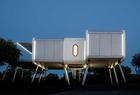 A space-age home with aircraft stairs