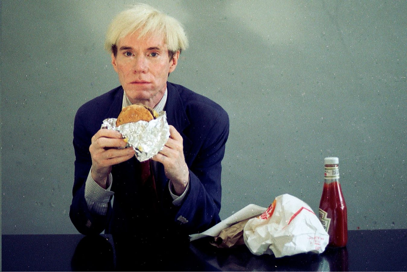Warhol and his burger in 66 Scenes from America