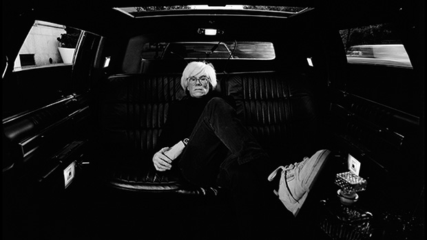 Andy Warhol in a limousine in New York City in 1986, by Elliott Erwit
