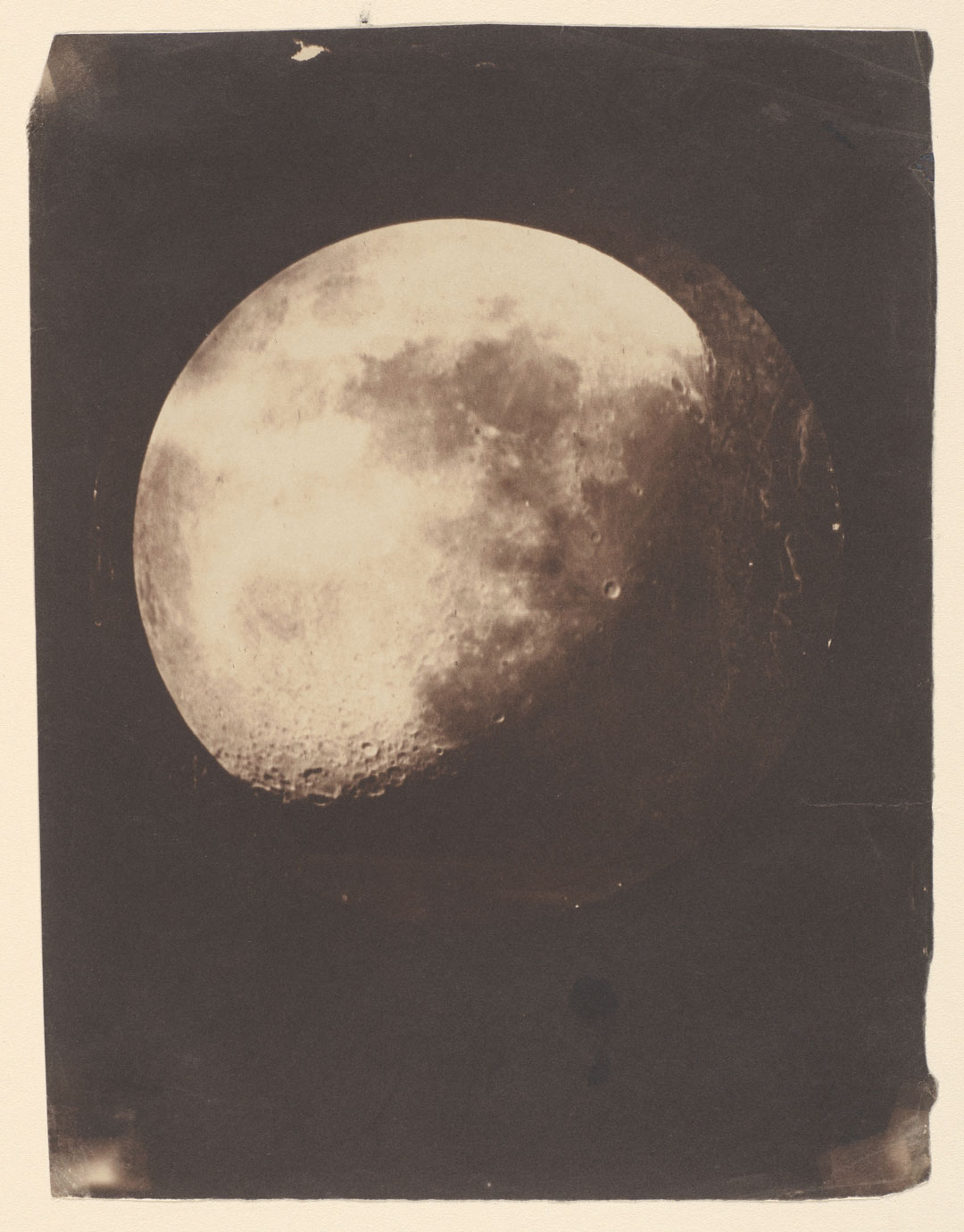 John Adams Whipple and James Black, The Moon, 1857–60, salted paper print made from a glass negative, 21.1 × 15.8 cm (8¼ × 6¼ in), copy of a daguerreotype made 193 at Harvard College Observatory, Cambridge, Massachusetts, Metropolitan Museum of Art, New York. Public domain. As reproduced in Sun and Moon