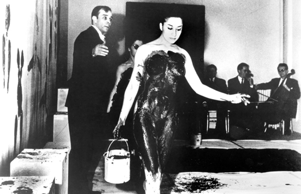 Yves Klein and a model during a perfomance of Anthropométries de l'époque bleue, Paris, 1960