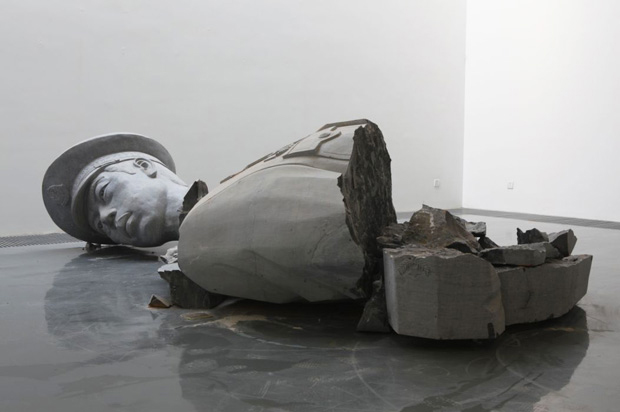Installation view of a broken officer sculpture by Zhao Zhao at Chambers Fine Art, 2011